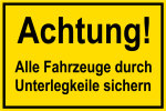 Construction site sign - Attenti ... e all vehicles with wheel chocks